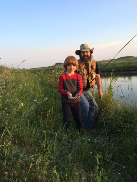 Father and son fishing at Cecil Thompson Park Peace River Alberta