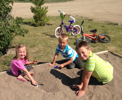 Children Playing in sand box at Rendez-Vous RV Park